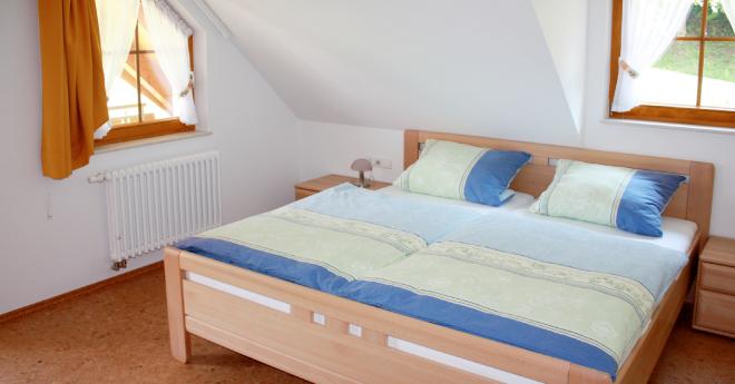 Bildslider: Wohnung DG - Schlafzimmer-1